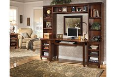"""The Daleena Home Office Desk System from Ashley Furniture HomeStore (AFHS.com). With the modular design that adapts perfectly to any home office along with ample storage space, the """"Daleena"""" home office collection features a rich brown cherry stain finish that flows beautifully over the half round pilaster accents and rounded feet to create the elegant look of traditional styled furniture."""