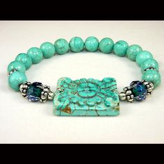 Carved Turquoise and Chinese Crystal Stretch Bracelet $27.90  Michaela is loving anything turquoise lately! This is beautiful