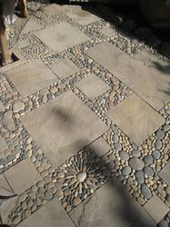 Wonderful paver and river rock mosaic patio surface, MetaMosaics. Could be a DIY project if I ever had the time.