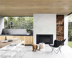 Outdoor kitchens: Round up of the best! Timber and concrete outdoor kitchen, sle… Outdoor kitchens: Round up of the best! Timber and concrete outdoor kitchen, sleek outdoor kitchen, modern outdoor kitchen Modern Outdoor Kitchen, Outdoor Kitchens, Modern Outdoor Fireplace, Modern Outdoor Living, Outdoor Fireplaces, Rustic Outdoor, Modern Outdoor Lights, Best Outdoor Lighting, Small Kitchens