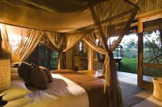 Pinner Says: Sandibe Safari Lodge accommodation is in 8 spacious stone, cottage-style rooms, elevated on separate viewing decks and all are river facing. They have been constructed under a canopy of trees, but are high enough to look out over the surrounding bush and reed beds.