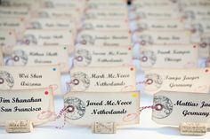 Luggage tags as placeholders, and name each table for a different destination.