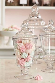 Pastel coloured meringues make pretty centrepieces or favours for nut-allergy sufferers who can't have traditional sugared almonds.
