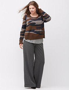 The military glam trend marches on with this on-point camo intarsia sweater with ribbon tie-back detailing. As cozy as it is chic, this soft crop top adds warmth to your trend collection with roll-cuff long sleeves and a flattering scoop neck. Ribbed trim and a vented hem complete the look. lanebryant.com
