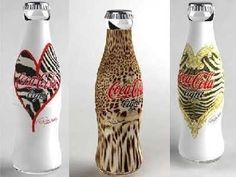 ROBERTO CAVALLI'S DRINK-ME-UP COKE BOTTLE DESIGNS