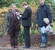 In good company: James was joined by co-star Robson Green, and the pair were later seen thumbing through a dog-eared shooting script during a break between scenes