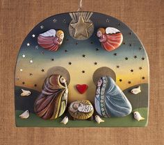 crib + from + wall + in + wood + and + stones + of + river + by + creo. Seashell Painting, Pebble Painting, Pebble Art, Stone Painting, Diy Painting, Rock Painting, Christmas Rock, Christmas Nativity, Christmas Crafts