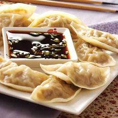 Chicken and mushrooms with Sriracha make up the filling in these potstickers, a traditional Chinese dumpling. Chicken Potstickers Recipe is shared by Jacquelynne Stine of Las Vegas, Nevada. Ravioli, I Love Food, Good Food, Yummy Food, Mets, Appetizer Recipes, Appetizers, Asian Recipes, Healthy Recipes