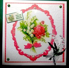 Carte faite pour le 1er Mai 2015 .... embossé cadre M.D. bouquet muguet rose pailleté et brin de muguet M.Design. agrémentée de demie perles.