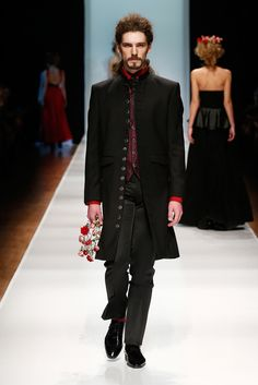 I know it's a man's coat, but I LOVE all those buttons ... From Russian Fashion Week.