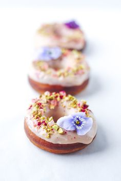 White Chocolate, Raspberry, Pistachio & Turkish Delight Donuts with edible flowers. Recipe and photography by The Hungry Cook