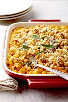 Please vegetarians with this cheesy, easy Christmas dinner menu. Rich pumpkin mac casserole alongside buttery roasted sprouts—it's such a decadent spread that no one will even notice the meat is MIA. #christmasmenu #christmasdinnerideas #christmasentree #holidaysidedish #bhg