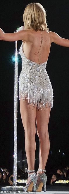 Super fit: TSwift displayed her lean legs in a fringed silver bodysuit See more at http://www.spikesgirls.com