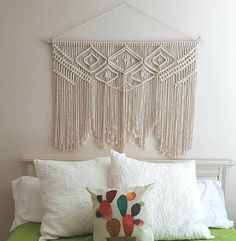 Large, 100% natural cotton macramé wall hanging. Measures approximately 34 from wooden dowel to longest point. Perfect for hanging above bed. **Please note-the color of the wall hanging is an off-white, natural unbleached cotton. As a made-to-order item, your wall hanging will ship in approximately 1-2 weeks. Please contact me if you happen to need the item sooner.