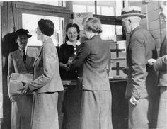 Guernsey Island residents receiving Red Cross food parcels during German occupation.
