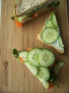 chive cream cheese, cucumber, shredded carrot sandwich