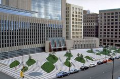 Austere, unfriendly and unusable (where the peoples?) landscape design that perfectly mimics the austere, unfriendly Courthouse buildings that, in turn, totally avoid any balance between people, their city and a natural environment - Minneapolis, MN, USA    p.s.: Machine-gun emplacements would have been a nice touch.