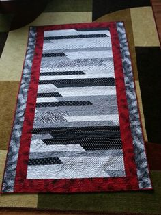Jelly roll quilt in black, white, and red