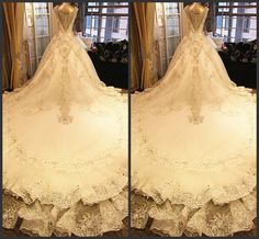 Oh wow look at the back of that ball gown wedding dress! I'm in love!