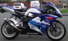 Suzuki TL1000R with a modern Suzuki tail grafted on, neatly! Gret Scorpion Tagma exhausts.