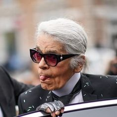 Karl Lagerfeld and other celebrities arrive at Fendi Fashion Show in Milan