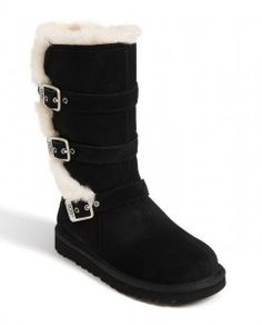 Tall black Uggs with white sheep skin details. Tween Fashion