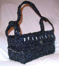 Upcycled VHS Candice Handbag   This funky, rectangular Candice bag is made from crocheting old VHS tapes and then lining it with re-purposed fabrics from thrift stores.