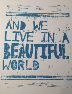 """And we live in a beautiful world..."" ""Ya we do, ya we do"". coldplay lyrics linoleum block print wall art. $22 on etsy."