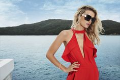 A lady in red, Lily Donaldson models a red jumpsuit with ruffles and sunglasses from River Island spring summer 2016 campaign