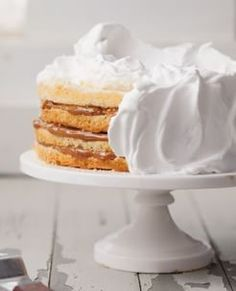 Dulce de Leche Cake | The ultralight white cake, layers of decadent dulce de leche and fluffy marshmallow-like frosting make this a melt-in-your-mouth dream.