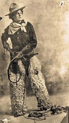 Nothing goes better with a pair of woolly chaps and a bullwhip than a six-shooter. Exhibition or trick shooters, like the sharp dressed woman in the studio photo, performed for audiences throughout the West, wowing fans by shooting aerial targets and dimes tossed in the air. Colt's New Army and Navy double-action revolvers were a favorite for professional shooters with considerable skill.  – Courtesy Denver Public Library –