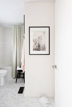 Black and white bathroom with framed photography