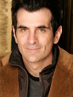 Ty Burrell (as Phil Dunphy on Modern Family)...He's a hot husband as his character and in real life.