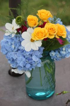 Mason jar with fresh flowers. Arrangement by Caroline of Floral Designs and More in Greer, S.C.
