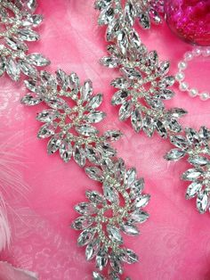 "XR120 Pre-Cut By the Yard Marquise Swirl Crystal Rhinestone Trim Embellishment 1.75"" (XR120-slcr). $39.99, via Etsy."
