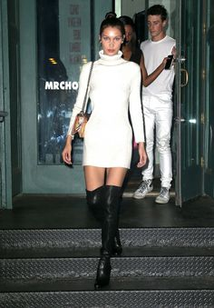 Bella Hadid in Baja East dress, Dior bag, and Stuart Weitzman shoes.