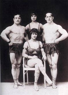 Ewald Redam (far left) was the principal athlete in a troupe of German strength performers who were active in the 20s. During WW I, Ewald, his Latvian life, Ludmilla, and two other athletes formed the Four Redams. The act was a great hit, even more remarkable because the women got as much attention for their strength feats as the men. In the 1930s, the group added two more strong women.