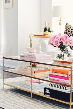 colorful coffee table vignette - idea on how to add colorful elements into your decor without being over the top Used Coffee Tables, Best Coffee Table Books, Coffee Table Vignettes, Coffee Table Images, Mirrored Coffee Tables, Coffee Table Styling, Diy Coffee Table, Decorating Coffee Tables, Chanel Coffee Table Book