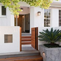 contemporary landscape by Creative Outdoor Solutions...great front gate! and clean lines!