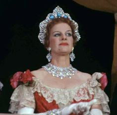 Rose Movius Palmer wearing the Westminster Halo tiara, sans Arcot diamonds, replaced with turquoise. She died in October 2003 and an auction of her possessions was held, but no mention of the tiara.
