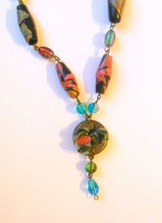 Bronze colour necklace with black, pink rose polymer clay beads and pendant.