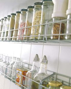 Recycled jars used as storage!  31 Practical Kitchen Rail Storage Ideas  - creative solutions for kitchen organization!