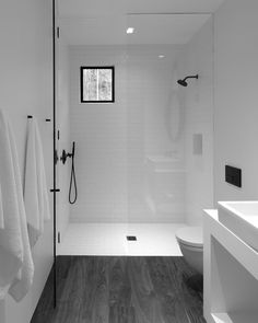 The minimalistic bathroom at the center of the studio separates the sleeping area from the living area . #MinimalistBathroom