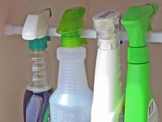 Cleaning Supply Storage Trick: Skip the shelf and hang bottles on the rod. http://www.hgtv.com/homekeeping/how-to-reduce-clutter-to-reduce-stress/pictures/page-2.html?soc=pinterest
