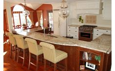 Kitchen with breakfast bar and white cabinetry-Home and Garden Design Ideas