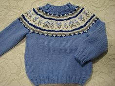 This is a worsted version of the pullover worn by Prince George in the British royal family Christmas photo of 2015. The yoke pattern is an exact replica of that in the original sweater.