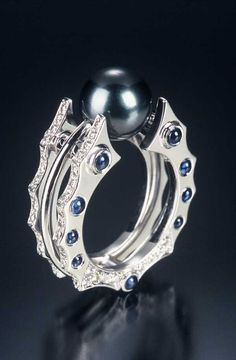 Ring | James Kaya. 'Total Eclipse' Platinum, diamonds, sapphires and black pearl