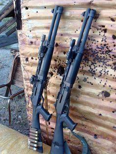 A pair of trekked out Benelli M1 Super 90 - 12 Gauge semi auto shotguns.