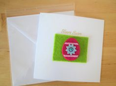This Easter egg card is decorated with felt egg, beautiful rhinestone & felt background.  This handmade easter card is 15x15 cm (6x6 in) in size and will come with a white envelope in a cellophane bag.  The inside of this easter card has been left blank for your own message.  All products used are of a high quality and all the work has been done by hand.  Your order will be dispatched within 2 days of receiving payment via royal mail first class.  I can personalise your card with name in ...