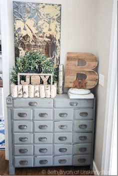 """Amazing blue apothecary cabinet from the Unskinny Boppy Home Tour. Love the big wooden """"B"""" as well!"""